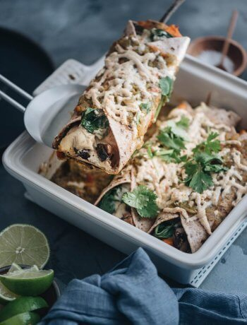 Serving vegan enchiladas