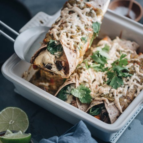Serving vegan enchiladas