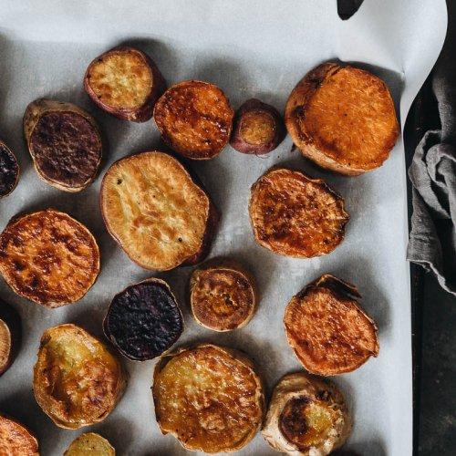 Crispy roasted sweet potatoes on baking sheet