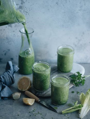Morning green smoothie in glasses on table