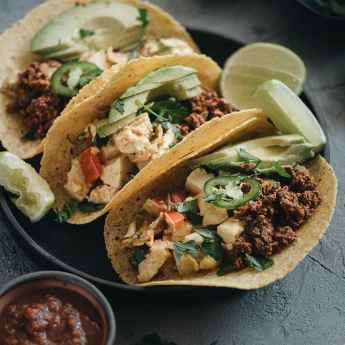 Three vegan breakfast tacos on a plate