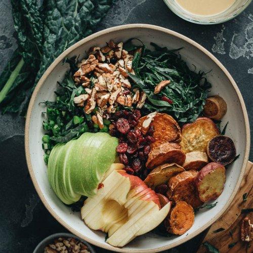 Vegan kale salad ingredients in bowl