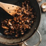 Crispy vegan shiitake mushroom bacon hot in the skillet