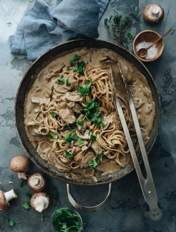 Cooking creamy vegan mushroom pasta for dinner