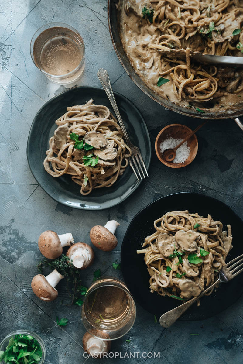 Dinner of creamy vegan mushroom pasta is served