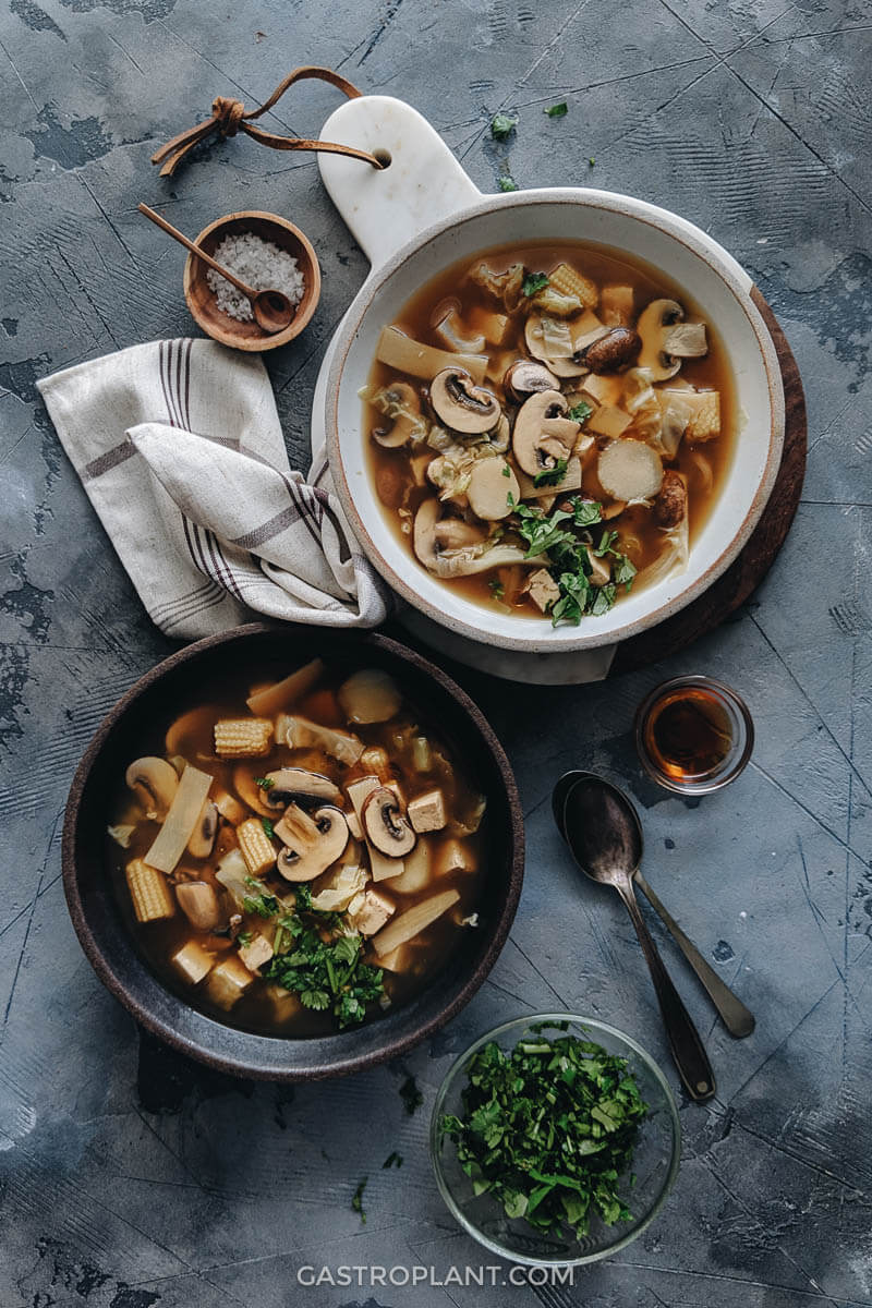 Bowls of steaming vegan hot and sour soup for dinner