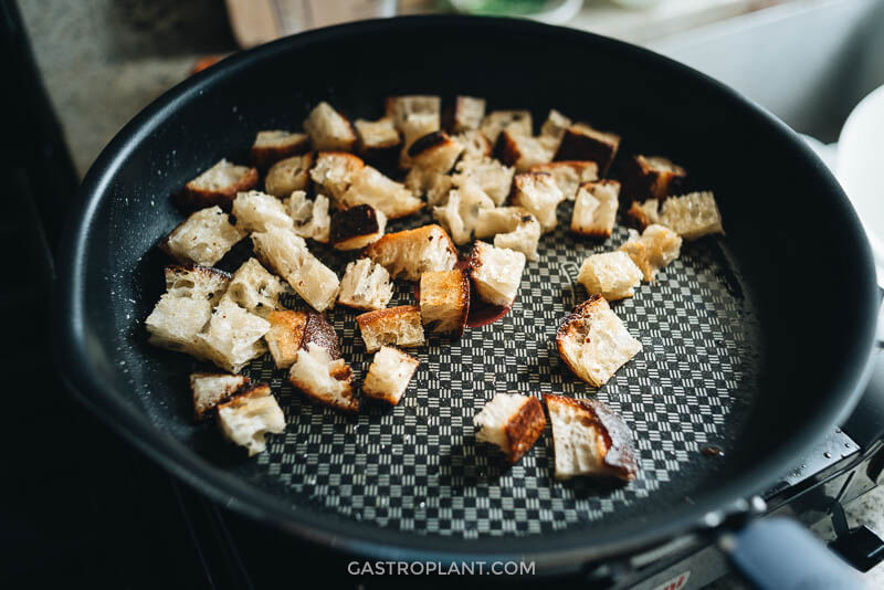Toasting croutons in a skillet