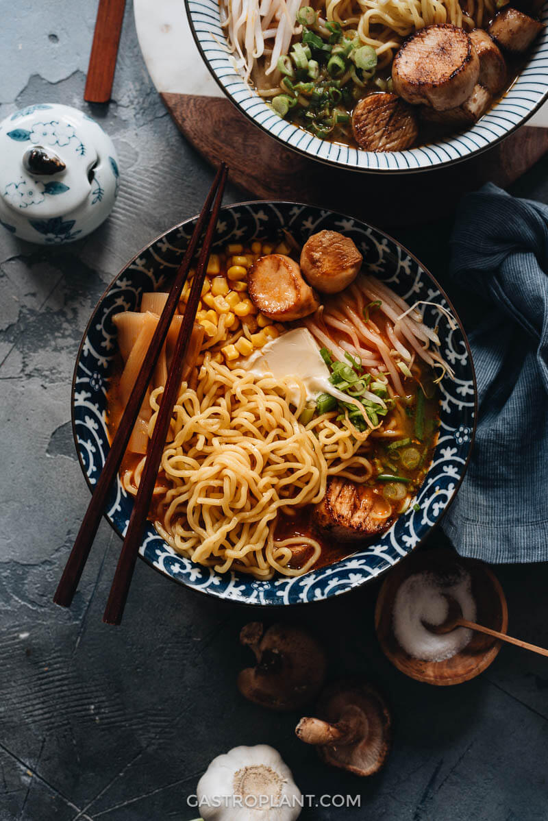 A bowl of vegan miso ramen noodle soup with vegan scallops