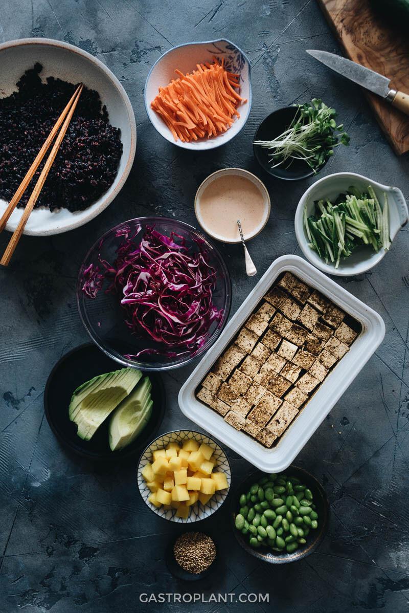Prepared vegan poke bowl ingredients on the table