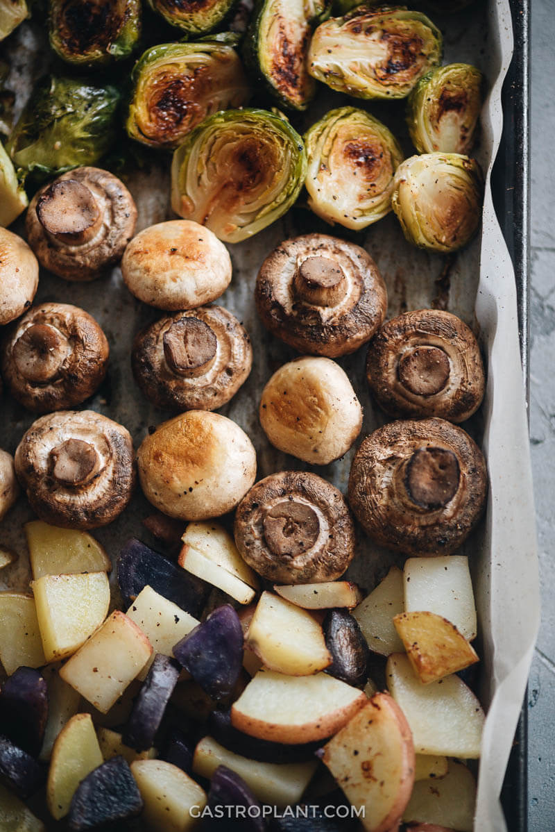 Close-up of roasted mushrooms, brussels sprouts, and potatoes