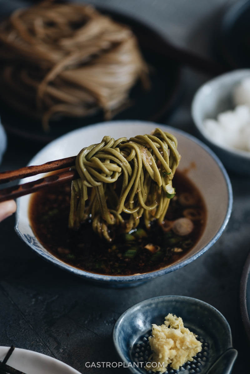 Dipping green tea soba noodles in vegan tsuyu sauce