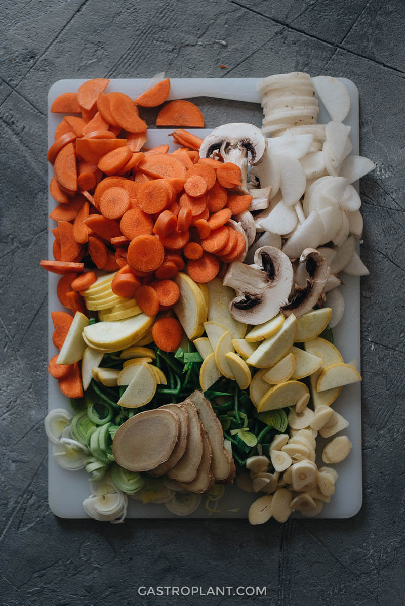 Chopped vegetables and herbs on a cutting board