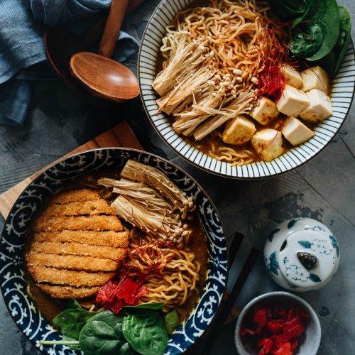 Two bowls of vegan curry ramen noodle soup
