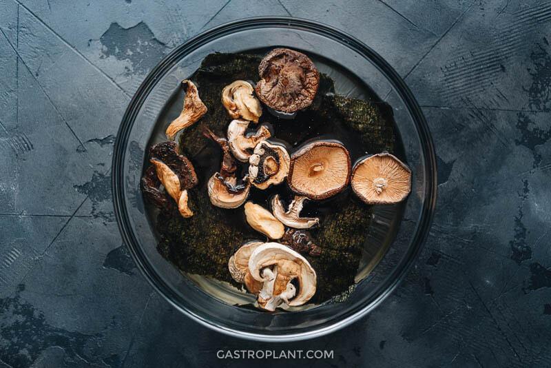 Making vegan dashi from shiitake mushrooms and kombu seaweed