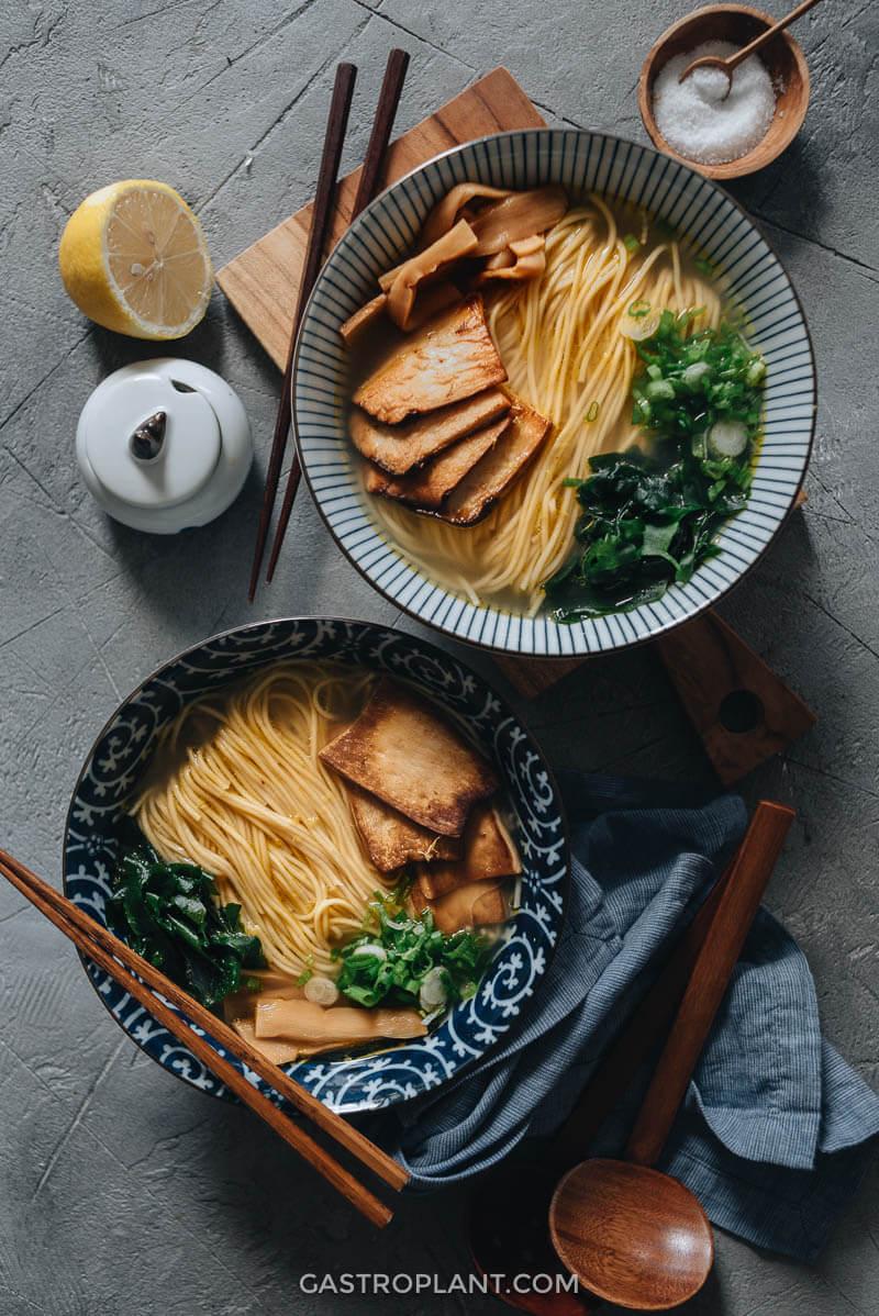 Two bowls of vegan shio ramen with seared king oyster mushroom