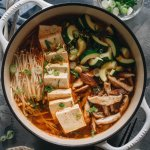 Easy vegan kimchi jjigae (stew) in a pot with tofu