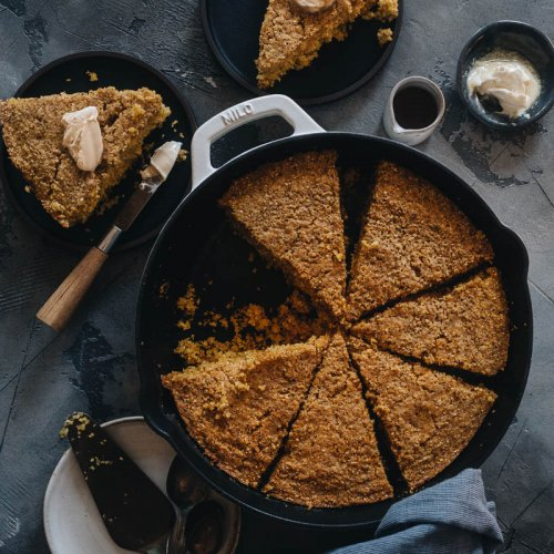 Vegan cornbread in a skillet with butter