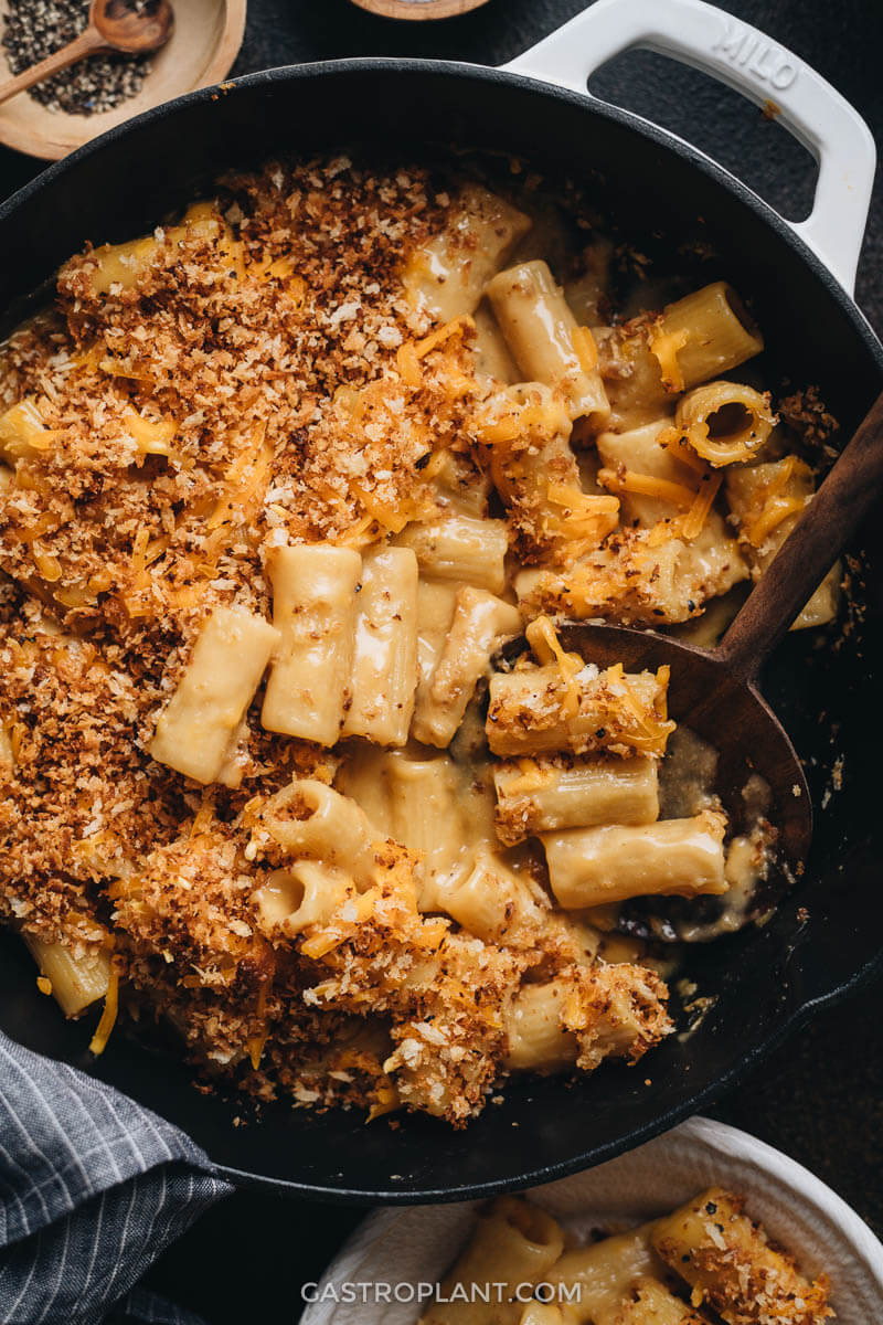 Close up of cheesy baked vegan mac and cheese