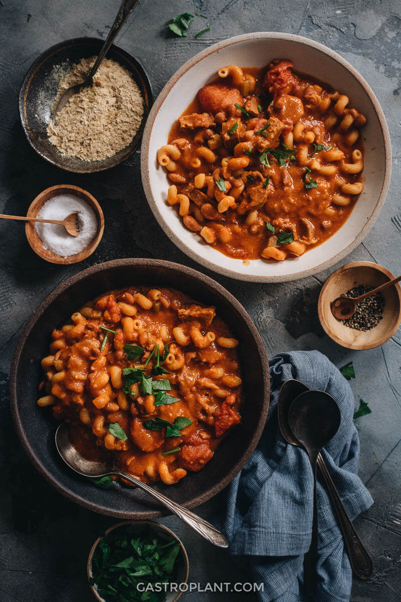 Vegan pasta e fagioli Italian soup with beans and vegan sausage