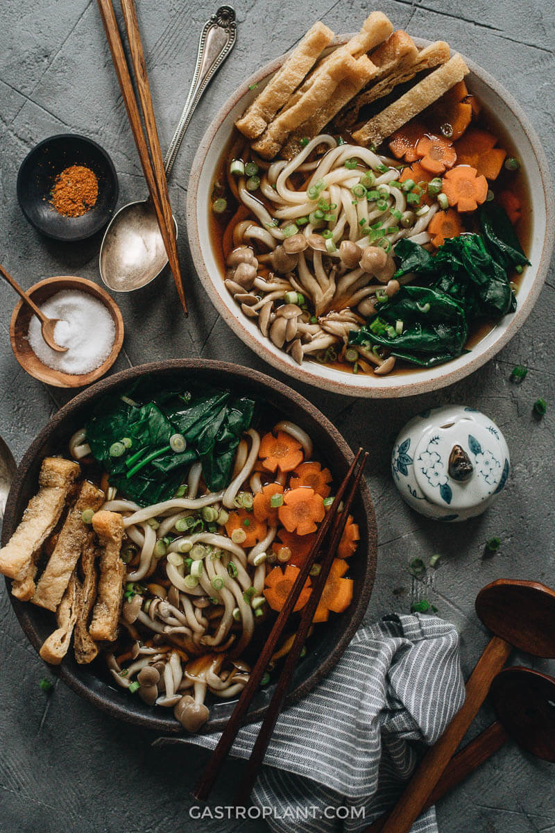 Two bowls of vegan udon soup with homemade broth