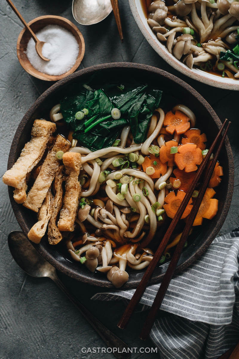Vegan udon noodle soup with tofu, carrot, mushroom and broth