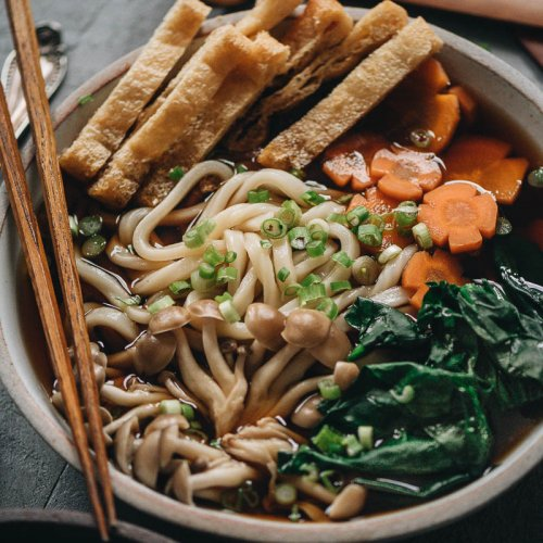 Vegan udon noodle soup with homemade broth and crispy tofu