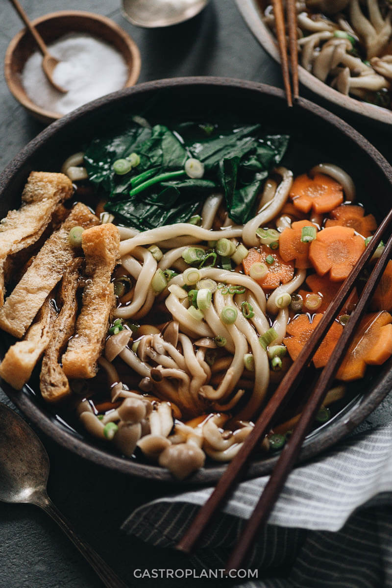 A steaming bowl of vegan udon noodle soup