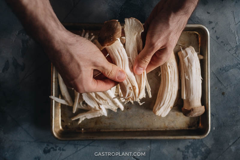 Tearing (shredding) king oyster mushrooms by hand
