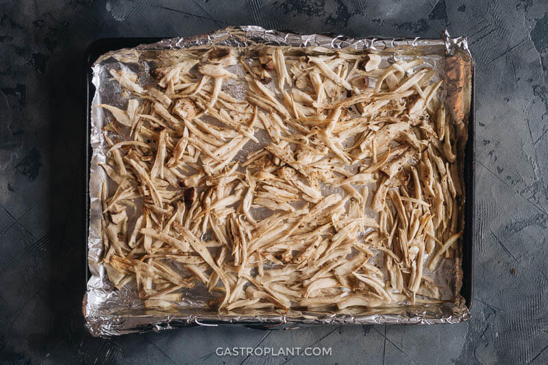 Shredded and roasted king oyster mushrooms