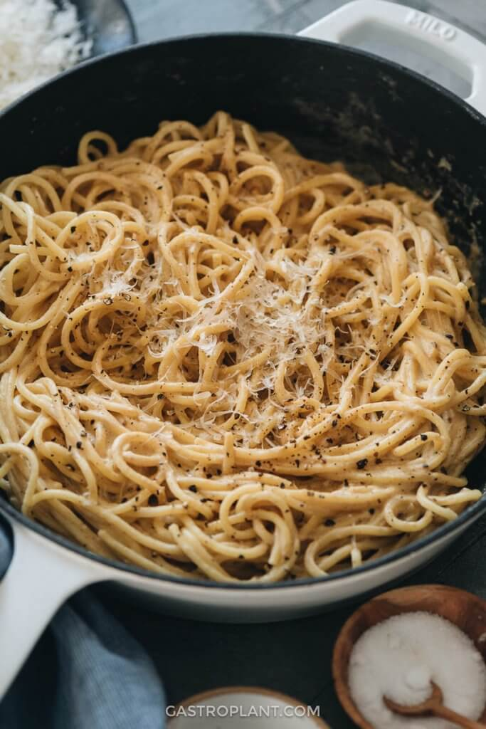 Close-up of vegan cacio e pepe pasta in a skillet