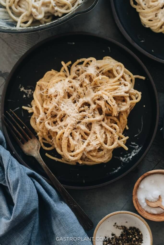 A plate of easy vegan cacio e pepe made from nuts