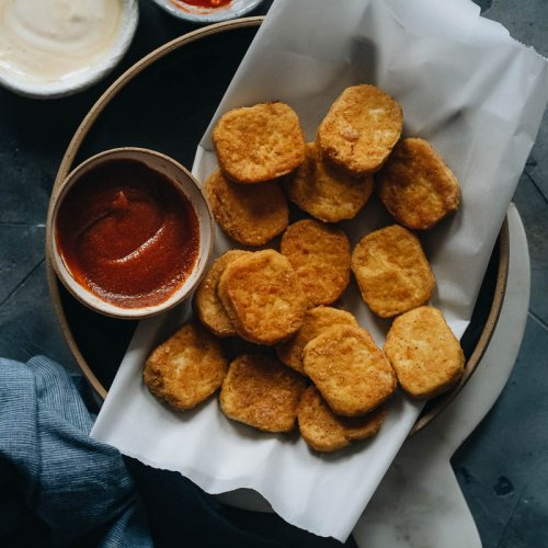 Crispy vegan chicken nuggets made from tofu on a plate