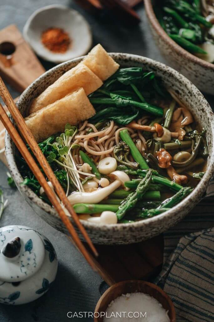 A hot steamy bowl of vegan soba noodle soup with veggies