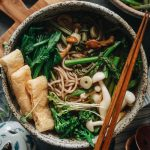 Soba buckwheat noodles in vegan tsuyu broth with green spring vegetables